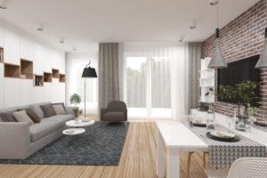 Salon z dużą sofą i zabudową na wymiar
